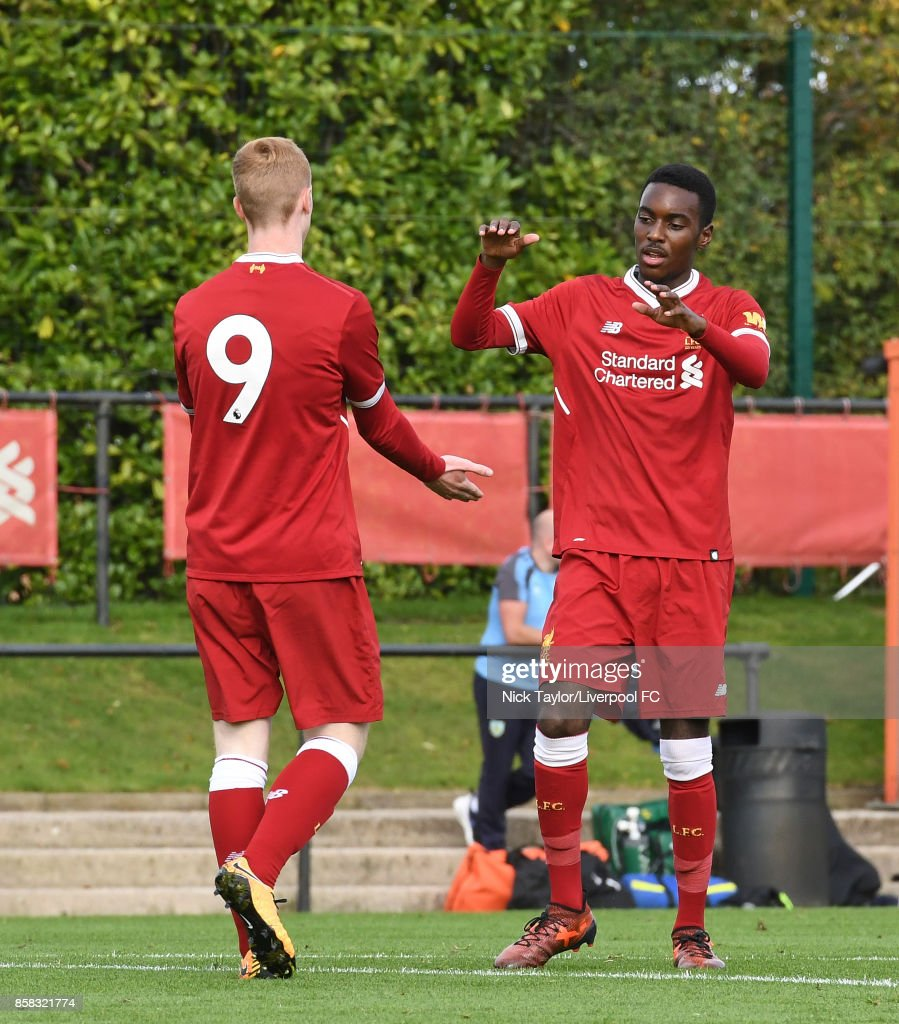 Glen McAuley (9) of Liverpool celebrates his goal with team mate Rafael Camacho during the U18 friendly match between Liverpool and Burnley at The Kirkby Academy on October 6, 2017 in Kirkby, England.