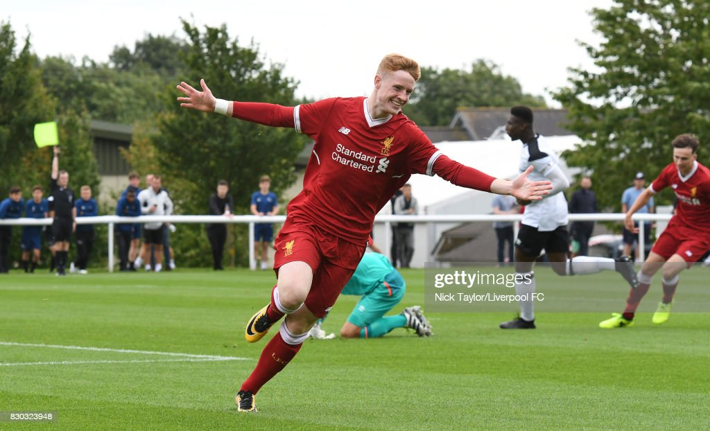 Glen McAuley of Liverpool runs in celebration after putting the ball in the goal, unaware of the assistant referee's raised flag for off-side during the Derby County v Liverpool U18 Premier League game at the Derby County Academy on August 11, 2017 in Derby, England.