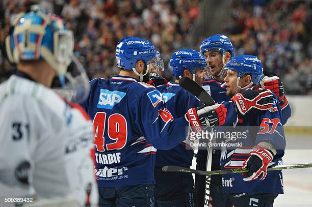 Glen Metropolit of Adler Mannheim celebrates as he scores the third goal during the Ice Hockey DEL match between Adler Mannheim and Eisbaeren Berlin...