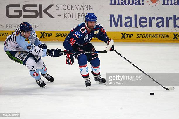 Glen Metropolit of Mannheim is challenged by Austin Madaisky of Straubing during the DEL match between Adler Mannheim and Straubing Tigers at SAP...