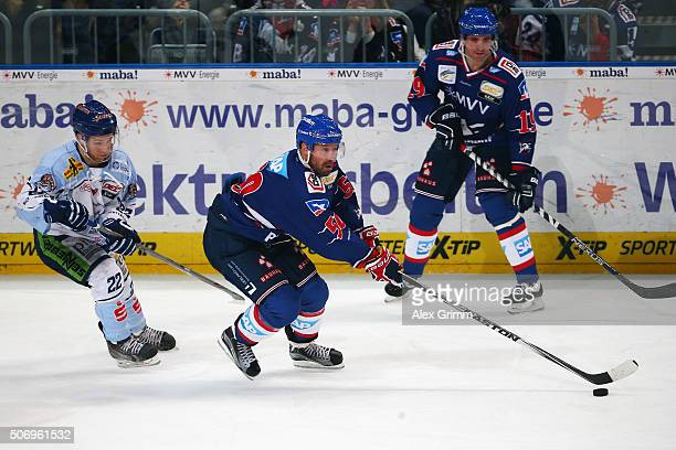 Glen Metropolit of Mannheim is challenged by Michael Connolly of Straubing during the DEL match between Adler Mannheim and Straubing Tigers at SAP...