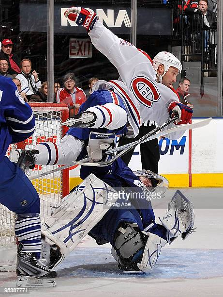 Glen Metropolit of the Montreal Canadiens collides with Jonas Gustavsson of the Toronto Maple Leafs during game action December 26 2009 at the Air...
