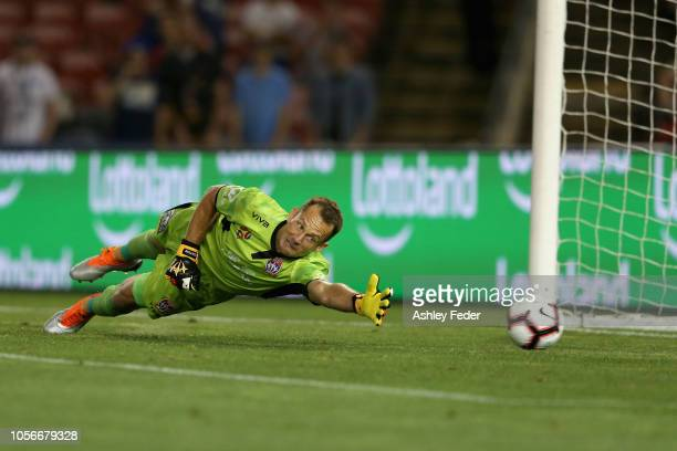 Glen Moss of the Jets fails to save a goal during the round three A-League match between the Newcastle Jets and the Melbourne Victory at McDonald...