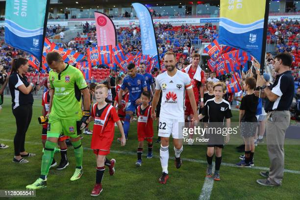 Glen Moss of the Newcastle Jets and Andrew Durante of Wellington Phoenix walk out before the start of the game during the round 18 ALeague match...