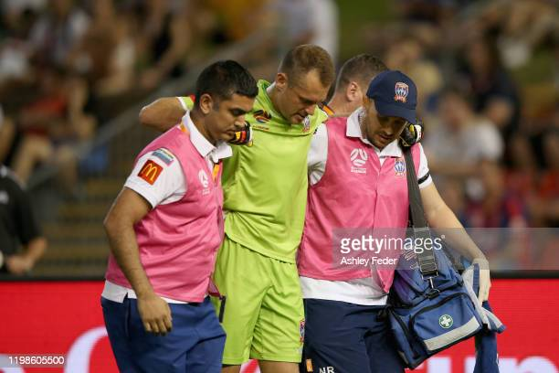 Glen Moss of the Newcastle Jets is taken off injured during the round 14 A-League match between the Newcastle Jets and Sydney FC at McDonald Jones...