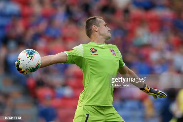 Glen Moss of the Newcastle Jets throws out from goal during the round 10 A-League match between the Newcastle Jets and Melbourne City at McDonald...