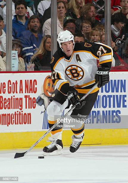 Glen Murray of the Boston Bruins skates the puck out of the defensive zone against the Buffalo Sabres on October 7, 2005 at HSBC Arena in Buffalo,...