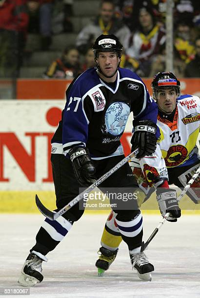 Glen Murray of the Primus Worldstars is guarded by Sebastian Bordeleau of SC Bern on December 15, 2004 at Bern Arena in Bern, Switzerland. The...