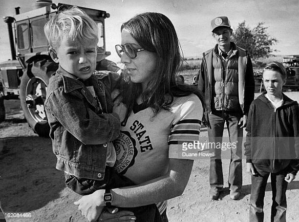 OCT 17 1980 OCT 19 1980 Glen Murray Rear Stands In Yard Of His Farm With His Wife Patty And Son Harvey And Son Byron 11 With the city encroaching on...