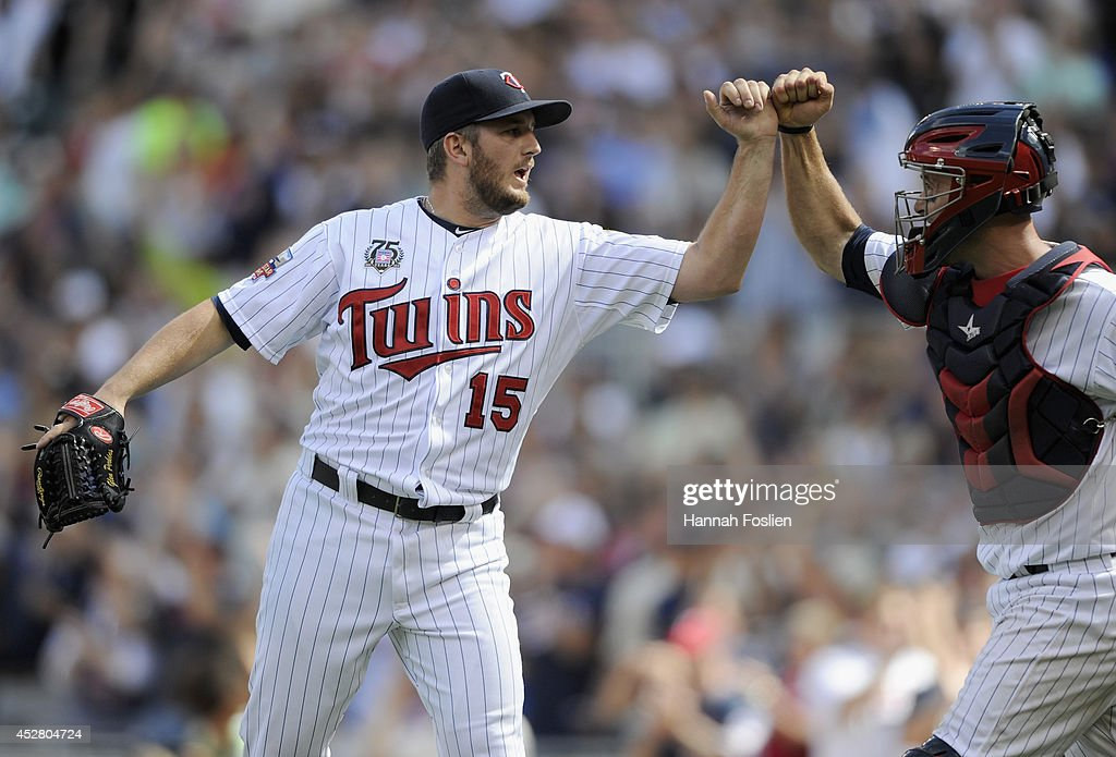 Glen Perkins #15 and Eric Fryer #26 of the Minnesota Twins celebrate a win of the game against the Chicago White Sox on July 27, 2014 at Target Field in Minneapolis, Minnesota. The Twins defeated the White Sox 4-3.