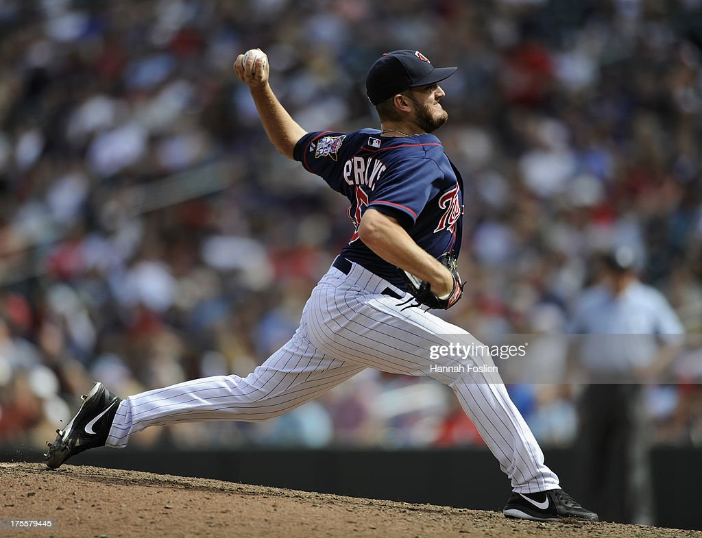 Glen Perkins #15 of the Minnesota Twins delivers a pitch against the Houston Astros during the ninth inning of the game on August 4, 2013 at Target Field in Minneapolis, Minnesota. The Twins defeated the Astros 3-2.