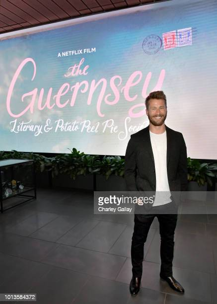 Glen Powell attends the Guernsey Cast Crew Screening at NETFLIX Icon Building on August 8 2018 in Los Angeles California