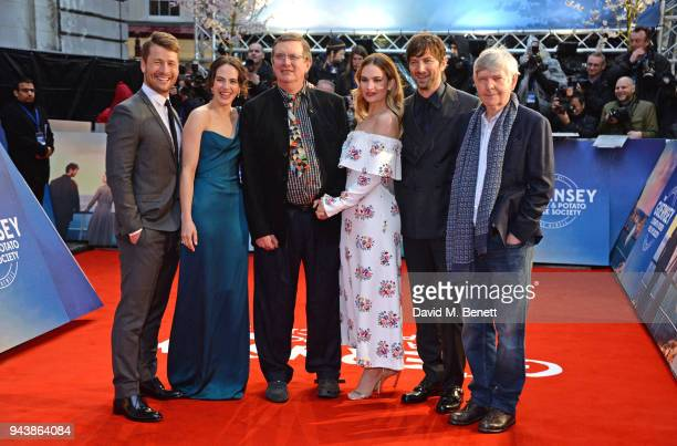 Glen Powell Jessica Brown Findlay director Mike Newell Lily James Michiel Huisman and Sir Tom Courtenay attend the World Premiere of The Guernsey...