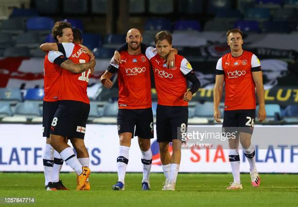 Glen Rea of Luton Town and team mates celebrate after victory in the Sky Bet Championship match between Luton Town and Blackburn Rovers at Kenilworth...