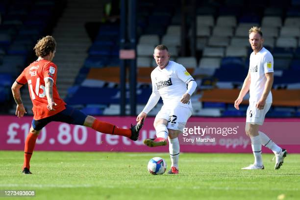 Glen Rea of Luton Town blocks a pass by Wayne Rooney of Derby County during the Sky Bet Championship match between Luton Town and Derby County at...