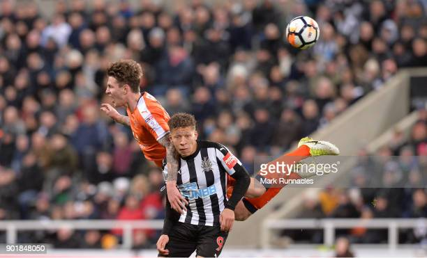 Glen Rea of Luton Town challenges Dwight Gayle of Newcastle United during the The Emirates FA Cup Third Round match between Newcastle United and...