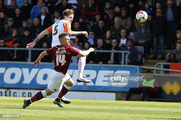 Glen Rea of Luton Town contests the ball with Sam Hoskins of Northampton Town during the Sky Bet League Two match between Northampton Town and Luton...