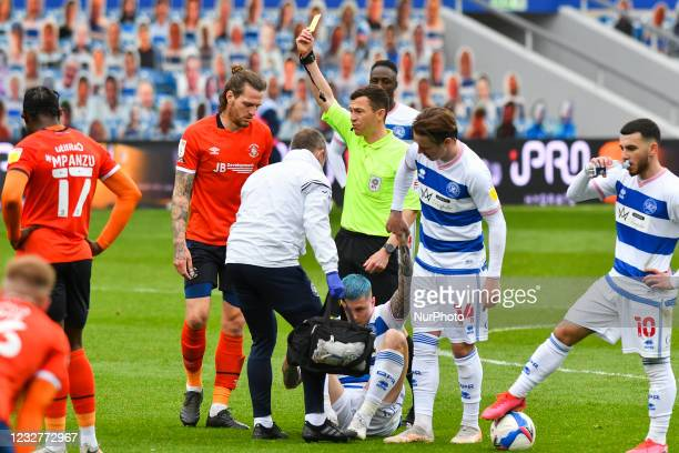Glen Rea of Luton town is shown a yellow card by the referee Tony Harrington during the Sky Bet Championship match between Queens Park Rangers and...