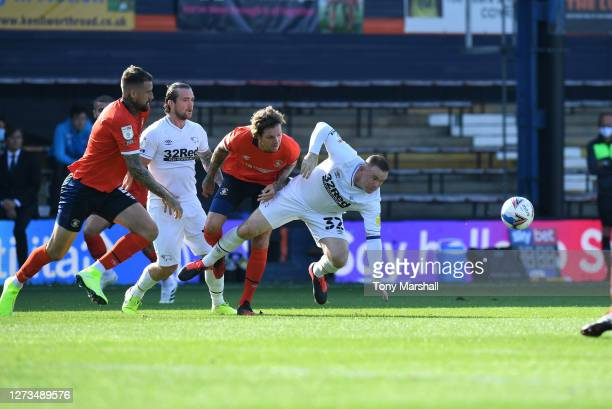 Glen Rea of Luton Town tackles Wayne Rooney of Derby County during the Sky Bet Championship match between Luton Town and Derby County at Kenilworth...