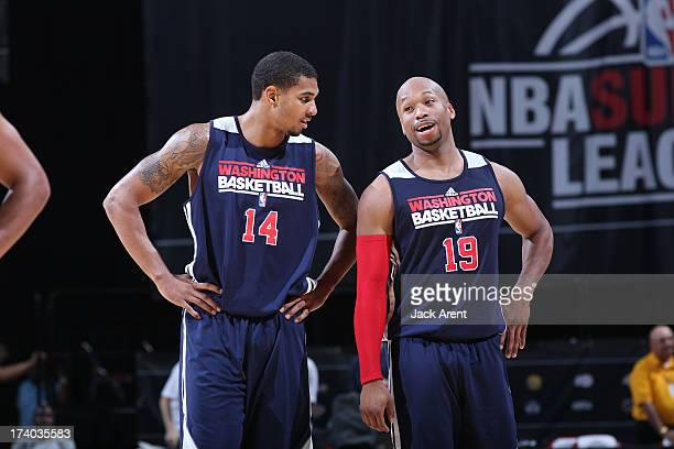 Glen Rice Jr and Sundiata Gaines of the Washington Wizards looks on versus the New Orleans Pelicans during NBA Summer League on July 19 2013 at the...