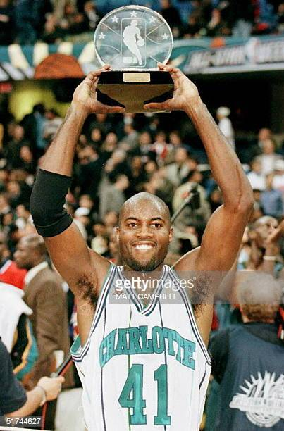 Glen Rice of the Charlotte Hornets holds up the Most Valuable Player trophy after the NBA AllStar Game 09 February at Gund Arena in Cleveland Ohio...
