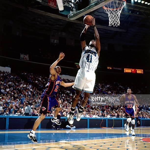 Glen Rice of the Charlotte Hornets shoots a jumpshot against the New York Knicks during an NBA game circa 1997 at the Charlotte Coliseum in Charlotte...