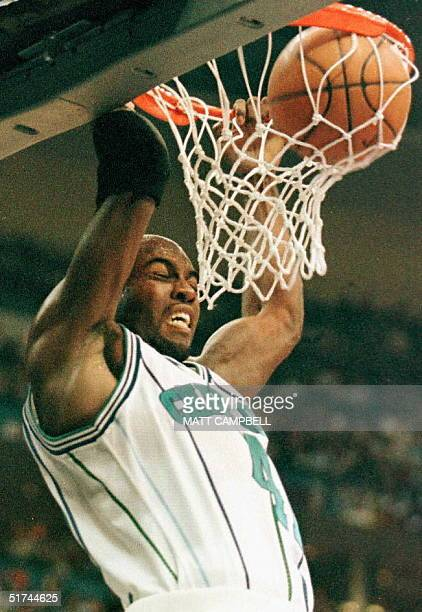 Glen Rice of the Charlotte Hornets slam dunks the ball for a score during the second half of the NBA AllStar Game 09 February at Gund Arena in...