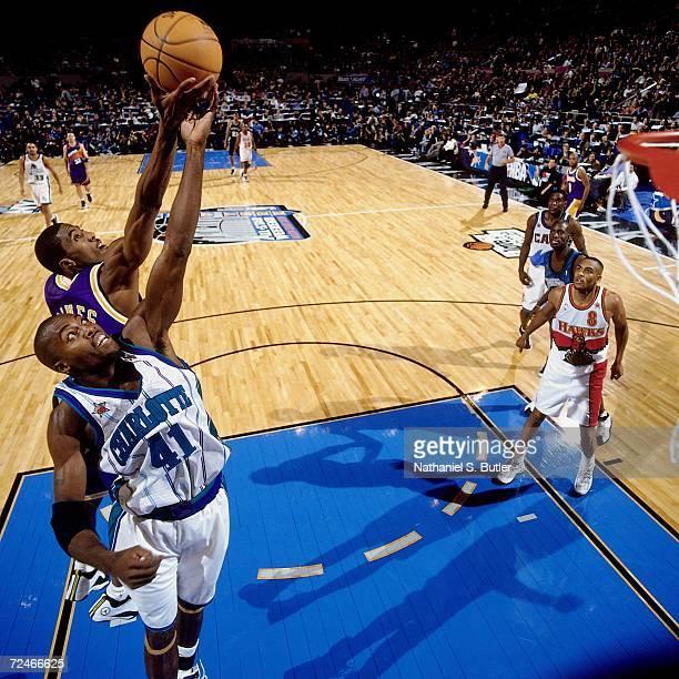 Glen Rice of the Eastern Conference AllStars battles for a rebound against Eddie Jones of the Western Conference AllStars during the 1998 NBA AllStar...