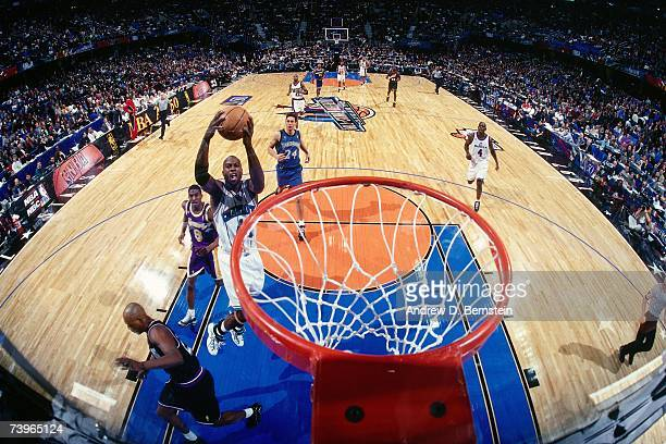Glen Rice of the Eastern Conference grabs the rebound against Eddie Jones of the Western Conference during the 1997 AllStar Game on February 9 1997...