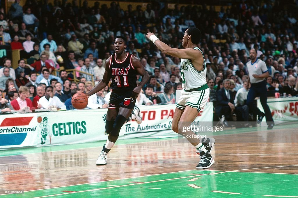 Glen Rice #41 of the Miami Heat drives the ball up court against Dennis Johnson #3 of the Boston Celtics during a game played in 1990 at the Boston Garden in Boston, Massachusetts.