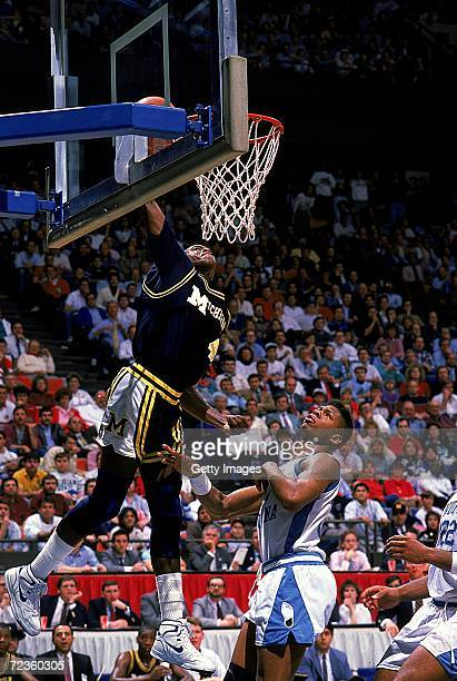 Glen Rice of the University of Michigan Wolverines makes a slam dunk during the game against the North Carolina Tar Heels