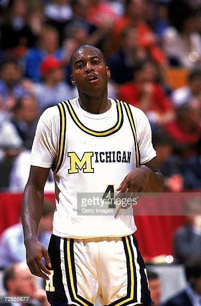 Glen Rice of the University of Michigan Wolverines walks on the court