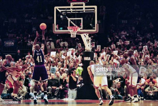 Glen Rice, Small Forward for the Charlotte Hornets shoots a free throw shot to the basket as Knicks fans try to put off his aim during Game 2 of the...