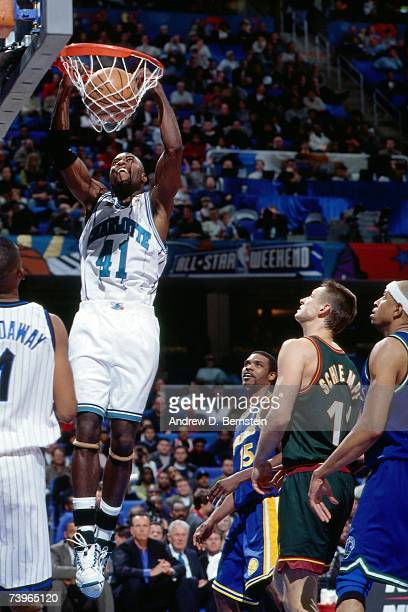 Glen Rice the Eastern Conference dunks against Detlef Schrempf of the Western Conference during the 1997 AllStar Game on February 9 1997 at Gund...