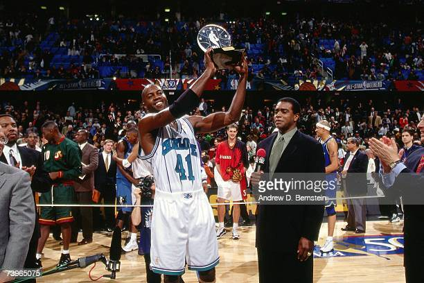 Glen Rice the Eastern Conference holds the MVP trophy following the 1997 AllStar Game on February 9 1997 at Gund Arena in Cleveland Ohio NOTE TO USER...