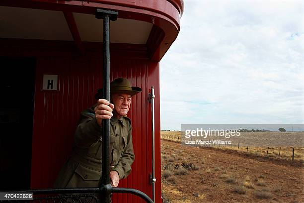 Glen Russell of the '1st Light Horse Regiment' looks out at the view from aboard the ANZAC Troop Train on April 20 2015 in Winton Australia The 2015...