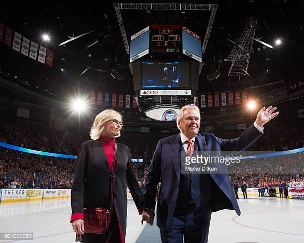 Glen Sather and Ann Sather leave the ice following the banner raising ceremony prior to the game between the Edmonton Oilers and New York Rangers on...