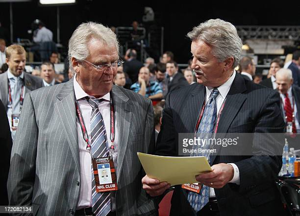 Glen Sather and Gordie Clark of the New York Rangers go over notes prior to the 2013 NHL Draft at the Prudential Center on June 30 2013 in Newark New...