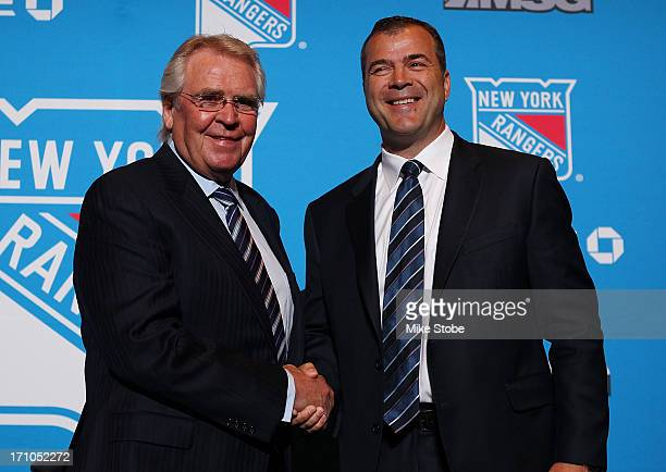 Glen Sather, New York Rangers President and General Manager and Alain Vigneault Head Coach of the New York Rangers pose for a photo during a press...