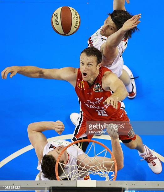 Glen Saville of the Hawks attempts to rebound during the round five NBL match between the Wollongong Hawks and the Melbourne Tigers at Wollongong...