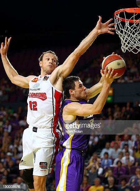 Glen Saville of the Hawks blocks Anatoly Bose of the Kings during the round three NBL match between the Sydney Kings and the Wollongong Hawks at...