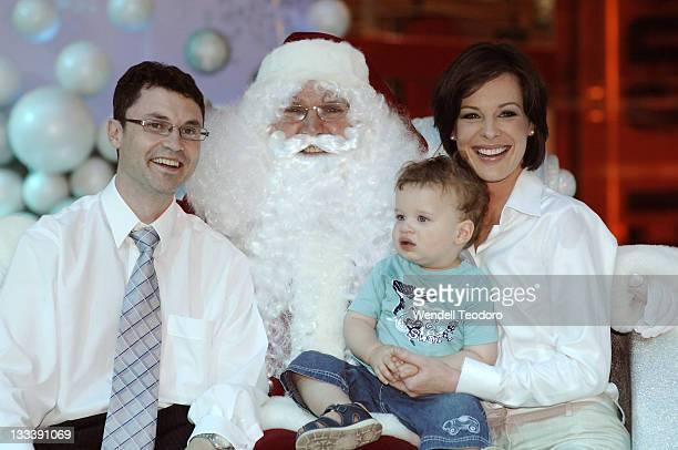 Glen Sealey Natarsha Belling poses with Santa Claus at Bondi Junction Westfield on November 16 2007 in Sydney Australia