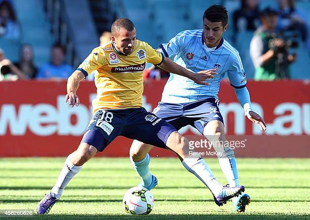 Glen Trifiro of the Mariners and Terry Antonis of Sydney FC in action during the round four ALeague match between Sydney FC and the Central Coast...