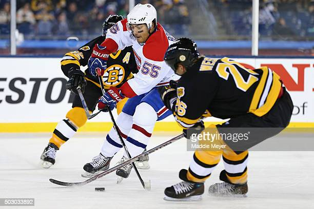 Glen Wasley of the Boston Bruins defends Francis Bouillon of the Montreal Canadiens during the 2016 Bridgestone NHL Winter Classic Alumni Game at...