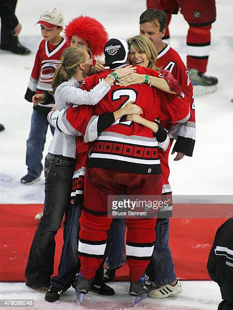 Glen Wesley of the Carolina Hurricanes is greeted by his family after defeating the Edmonton Oilers to gain the NHL Stanley Cup on June 19 2006 at...