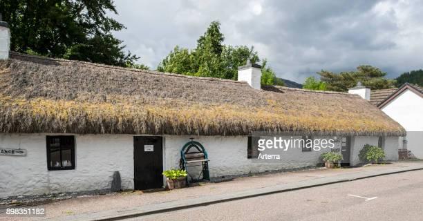 Glencoe North Lorn Folk Museum in restored longhouse with thatched roof Lochaber Scottish Highlands Scotland United Kingdom