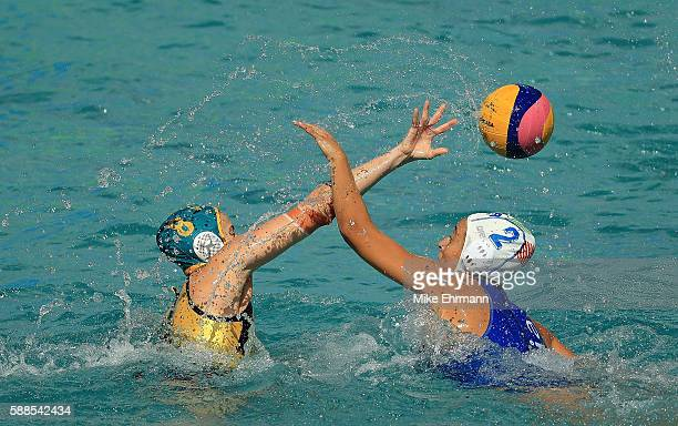 Glencora Mcghie of Australia passes over Chiara Tabani of Italy during a Womens Preliminary match on Day 6 of the 2016 Rio Olympics at Maria Lenk...