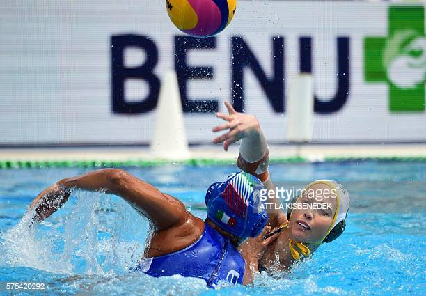 Glencora Meghie of Australia shoots the ball past Chiara Tabani of Italy in the 'Hajos' swimming pool of Budapest on July 15 2016 during a Benu Cup...