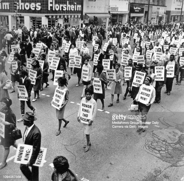 Glenda Strong Robinson a Junior at Memphis State University marches on Main Street in Memphis Tennessee on April 8 during a Memorial March after the...