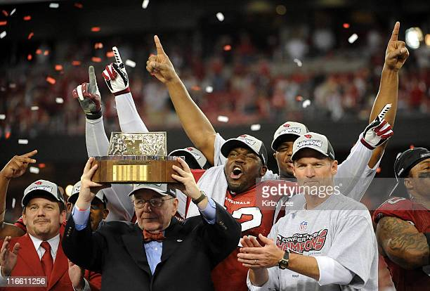 Glendale AZ USA Arizona Cardinals owner William Bidwill holds the the George Halas trophy flanked by president Michael Bidwill defensive end Bertrand...